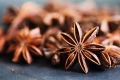 Anise stars closeup in wooden bowl on dark background Royalty Free Stock Images