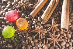 Anise stars , coffee beans, cinnamon sticks and colorful candies Stock Images
