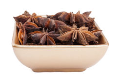 Anise stars in a golden bowl Royalty Free Stock Photography