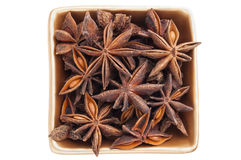 Anise stars in a golden bowl Stock Photo