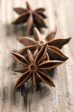 Anise stars on the vintage wooden surface Stock Photos