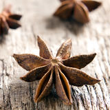 Anise stars on the vintage wooden surface