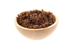 Anise stars in a wood bowl Royalty Free Stock Photography