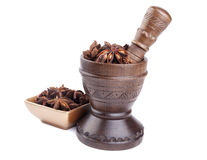 Anise stars in wooden mortar and  golden bowl Stock Photography