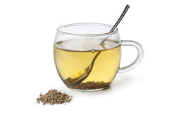 Anise tea in a glass. And seeds on white background stock photography