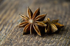 Anise on a wooden background in warm colors Royalty Free Stock Photography
