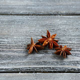 Anise on wooden boards Royalty Free Stock Image