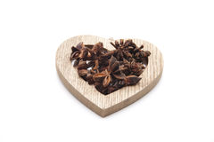 Aniseed in the heart symbol Stock Photos