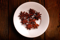 Aniseed stars on a plate Royalty Free Stock Images