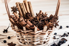 Anisetree and cinnamon in a wicker basket. Fragrant anisetree and cinnamon stacked in a wicker basket Stock Image