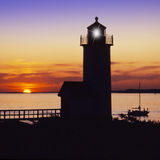 Anisquam lighthouse. Lighthouse at sunset with orange and blues located near gloucester, ma. usa Stock Photo