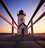 Anisquam lighthouse after sunset. Lighthouse shot just after sunset located on the coast of massachusetts Stock Photos