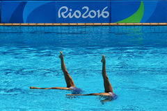 Anita Alvarez and Mariya Koroleva of team USA compete during synchronized swimming duets free routine preliminary of the Rio 2016 Stock Photos