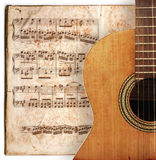 Anitique guitar. Ancient music sheet, rusted old yellow paper with guitar Royalty Free Stock Images