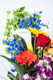 Aniversary bouquet. Lush holiday bouquet full of orchids, roses and lillies in silver vase Stock Photography