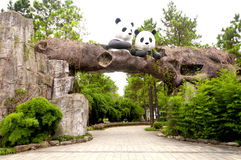 Anji Bamboo Museum Park. Two panda's sitting on top of an arch way over a stone path in Anji's Bamboo Museum Park located near Huzhou City, in Zhejiang Province Stock Image