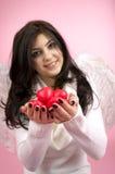 Anjo branco com corações vermelhos Fotografia de Stock