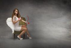 Anjo com curva e seta Fotografia de Stock