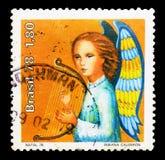 Anjo com harpa, serie do Natal, cerca de 1978 Imagens de Stock