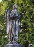 Anjo de pedra, drapejado, voado, descalço, guardando a âncora fotografia de stock