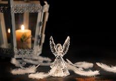 Anjo de vidro em um fundo escuro fotos de stock