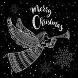 Anjo do Feliz Natal com chifre e neve Fotografia de Stock Royalty Free