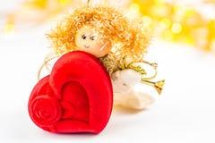 Anjo do Natal e coração vermelho de veludo Imagens de Stock Royalty Free