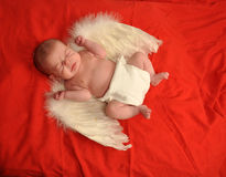 Anjo Sneezing do bebê Imagens de Stock Royalty Free