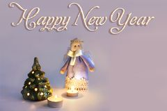 Anjo, velas e árvore de Natal fotos de stock