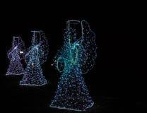 Anjos do Natal em um fundo preto Fundo Fotografia de Stock