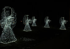 Anjos do Natal em um fundo preto Fundo Fotografia de Stock Royalty Free