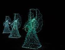 Anjos do Natal em um fundo preto Fundo Fotos de Stock