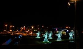 Anjos do Natal em um fundo preto Fundo Imagem de Stock Royalty Free