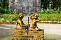 Anjos dourados da fonte Imagem de Stock