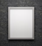 Ank space poster or art frame waiting to be filled. On wall Royalty Free Stock Photography