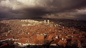 Ankara top view on city big black clouds run and cover town with shadow speedy shooting. Ankara capital of Turkey Cityscape early spring stock footage