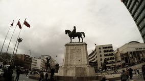 Memorial of Ataturk on horse square turkish flags passersby pigeons cloudy day Ankara. Ankara capital of Turkey cityscape early spring stock video footage