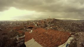 Tile roofs top view on Ankara far turkish flag cloudy day. Ankara capital of Turkey Cityscape early spring stock video