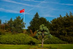 Ankara , Turkey: Turkish red flag is developing in the wind in the Park near the mausoleum Mustafa Kemal Ataturk. Ankara the capital of Turkey: Turkish red flag royalty free stock photography