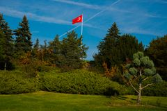Ankara , Turkey: Turkish red flag is developing in the wind in the Park near the mausoleum Mustafa Kemal Ataturk. Ankara the capital of Turkey: Turkish red flag royalty free stock photos