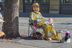 Ankeny Square`s Street Entertainer in Portland,Oregon. Portland, Oregon, USA - September 20, 2014: A street entertainer dressed as a foil man sits in a camp Royalty Free Stock Photos