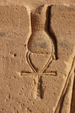 Ankh. Detail of a carving of an ancient egyptian goddess holdingan akh Royalty Free Stock Photos