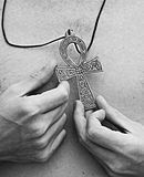 The Ankh. An ankh held by anonymous hands Stock Photography
