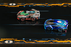 Anki Overdrive - modern toy car racing. Ostfildern, Germany - November 8, 2015: The new Anki Overdrive smart toy car racing is set up in a living room.  The Stock Images