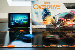 Anki Overdrive - modern toy car racing. Ostfildern, Germany - November 8, 2015: The new Anki Overdrive smart toy car racing is set up on a living room table Stock Photos