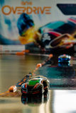 Anki Overdrive - modern toy car racing. Ostfildern, Germany - November 8, 2015: The new Anki Overdrive smart toy car racing is set up in a living room together Stock Photos