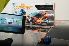 Anki Overdrive toy car racing. Ostfildern, Germany - November 1, 2015: Test drive of the new Anki Overdrive smart toy car racing using an app on the Apple iPad Stock Image