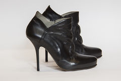 Ankle boots. Black leather ankle boots on white Stock Photos