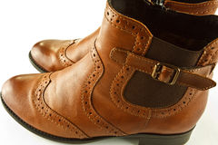Ankle boots. A closeup of tan leather ladies ankle boots stock photos