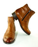 Ankle boots. A closeup of tan leather ladies ankle boots royalty free stock photography